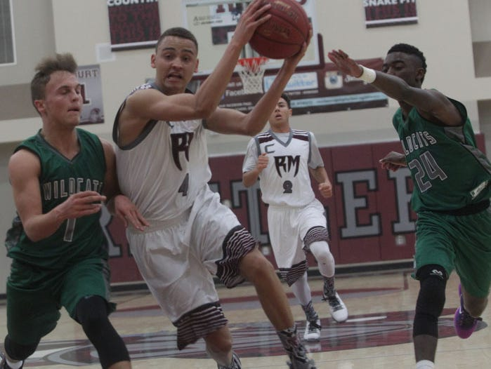 In white uniforms, Rancho Mirage High hosted Twentynine Palms High School. Rancho Mirage won 76-71 and continues with zero losses during the season.