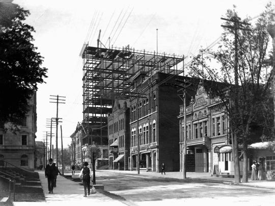 Many telephone and electric lines dot Chenango Street in 1904.