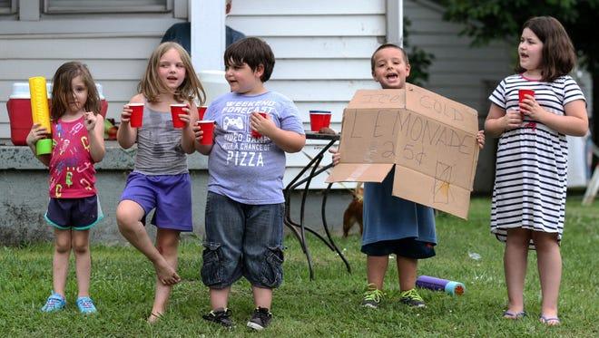 Children sell lemonade on July 19 in Owensboro, Ky.