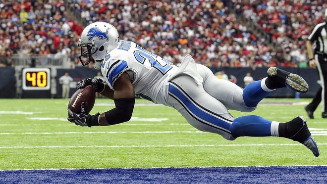 Lions running back Theo Riddick makes a touchdown reception during the fourth quarter against the Houston Texans at NRG Stadium.