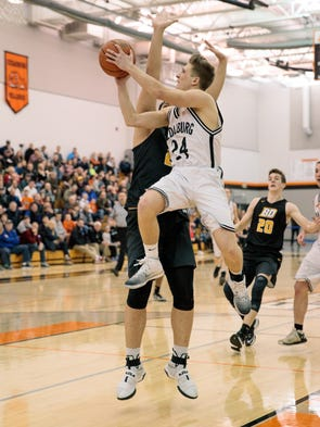 Cedarburg's Clayton Van Tassel (24, white) drives to