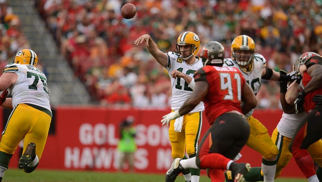 Green Bay Packers quarterback Aaron Rodgers (12) throws a pass during the fourth quarter of Sunday's game against the Tampa Bay Buccaneers at Raymond James Stadium in Tampa, Fla.