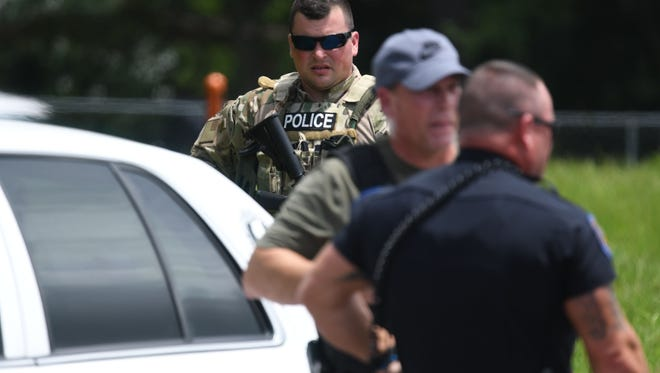 Hattiesburg police shut off West Fourth Street between 38th Avenue and West Hulls Drive as they search for Victory Kirksey, a suspect of aggravated assault on a police officer on Monday, June 18, 2018.