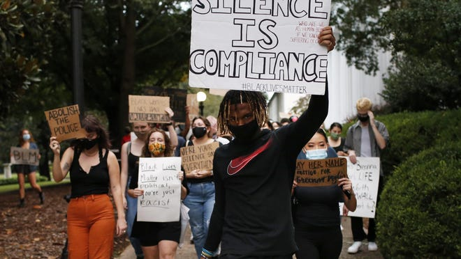 Protest organizer and UGA student Josh Stinson leads a demonstration in response to the Breonna Taylor grand jury verdict through the North Campus quad on Sept. 25, 2020.
