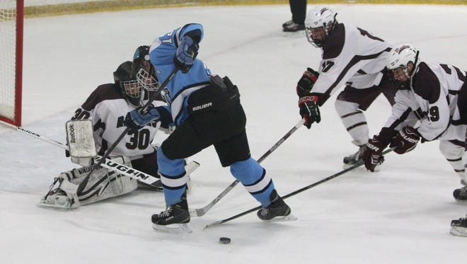Suffern's Mike Ruthberg is stopped by Scarsdale goalie Sam Seltzer, Stephen Nicholas and Charles Gliatta during their game at the E.J. Murray rink in Yonkers Dec. 7, 2015. Scarsdale won 1-0.
