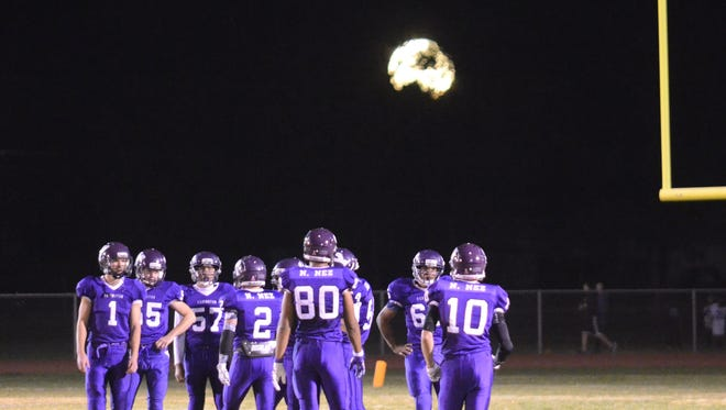 A full moon rises over Mason Valley while the Yerington football team waits for one of many kickoffs during last Friday's 66-12 first-round playoff victory over Incline.