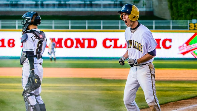 Brendan Baker of Grand Ledge celebrates after scoring to cut the Holt lead to one in the 5th inning of their Diamond Classic championship game Wednesday.