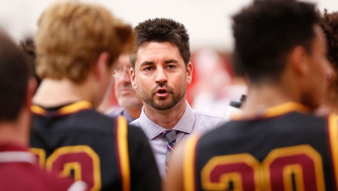 McCutcheon head coach Tyler Scherer talks to his players during a timeout as they face West Lafayette Wednesday, November 22, 2017, in West Lafayette. McCutcheon defeated West Lafayette 61-60.
