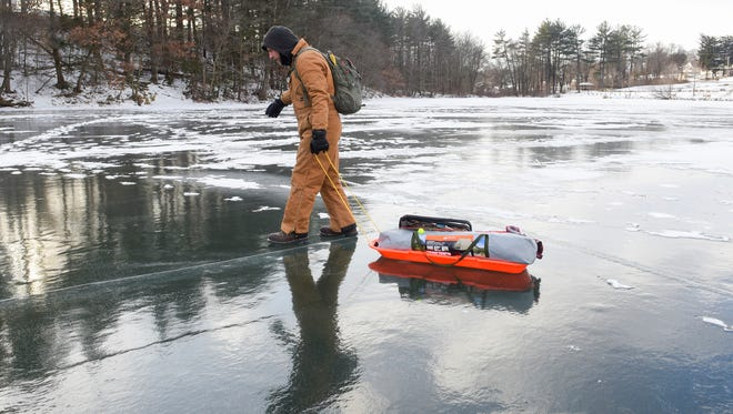 Ben Reigert of Reading, Pa., walks onto the ice at Sweet Arrow Lake to fish on Jan. 6, 2017, in Pine Grove, Pa. Freezing temperatures since Dec. 26 have made for ideal ice fishing conditions.