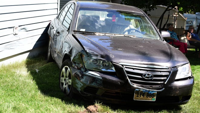According to the residents of the house, the car tried to back away after striking their neighbors fence Thursday, May 31, 2018.