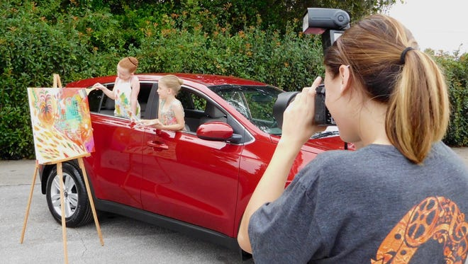 Gwyneth Shoemaker and Julia Perkins get creative during the photo shoot.