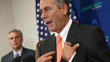 """Speaker of the House John Boehner, R-Ohio, joined at left by Majority Leader Kevin McCarthy, R-Calif., says Senate Democrats should """"get off their ass"""" and pass a bill to fund the Homeland Security Department and restrict President Barack Obama's executive moves on immigration, at a news conference following a GOP strategy meeting, at the Capitol in Washington, Wednesday, Feb. 11, 2015. His comments Wednesday underscored a worsening stalemate on Capitol Hill with funding for the Homeland Security Department set to expire Feb. 27. A day earlier, Senate Majority Leader Mitch McConnell declared the Senate """"stuck"""" on the issue and said the next move was in the House's court. (AP Photo/J. Scott Applewhite) ORG XMIT: OTK"""