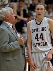 Dowling Catholic head coach Bob Hanson talks with Audrey Faber in the closing minutes of a 64-44 win over West Des Moines Valley in 2014.