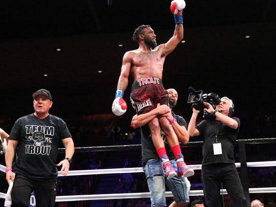 Area boxer Austin Trout is raised up at the end of