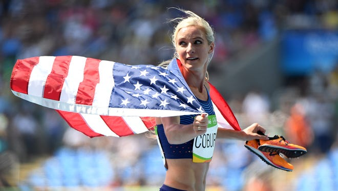 Emma Coburn celebrates the bronze medal in the women's 3000 steeplechase.