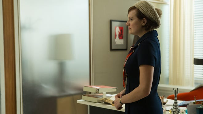 Peggy (Elisabeth Moss) takes in the view after temporarily moving into Don's office.