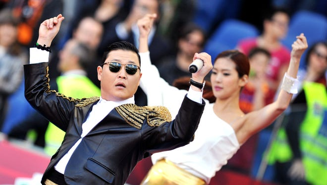 Psy performs 'Gangnam Style' prior to the Italian Cup football final on May 26, 2013.