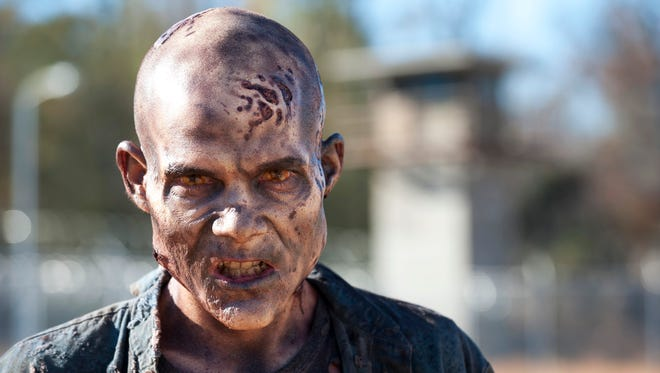 Frank Darabont, the creator of the zombie-themed TV series 'The Walking Dead,' is suing AMC.