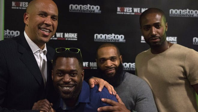 """At the Newark Black Film Festival on Aug. 3, Sen. Cory Booker is pictured from left to right  """"Moves We Make"""" Producer Lamar Mackson, writer J.M. Benjamin and star John Anthony Wylliams. Set and shot in Plainfield, the film, based on Benjamin's short story """"Checkmate,"""" won a Paul Robeson Award at the festival."""