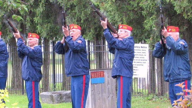 Members of the E.J. Brewer Detachment of the Marine Corps League fire a rifle salute during last year's Memorial Day service at Fitzsimmons Cemetery in the Town of Southport.