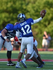 Zairn Davis of Summit Country Day launches a pass downfield