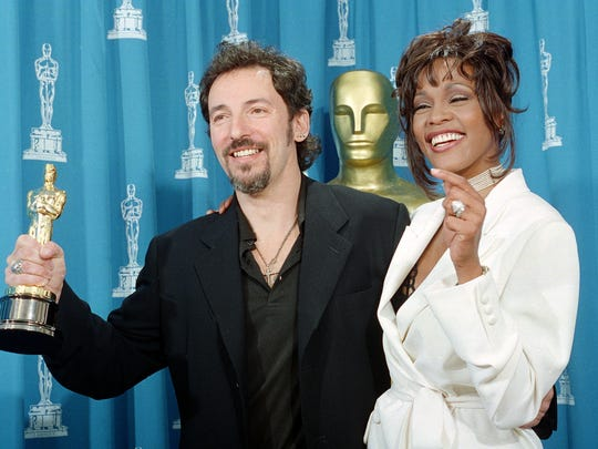 Bruce Springsteen and Whitney Houston pose backstage at the 1994 Academy Awards.
