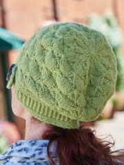 The Verdure Buttoned Cloche is a cute hat with a headband that is knitted perpendicular to the body. You can get a copy of this pattern for free on my In Stitches blog today.