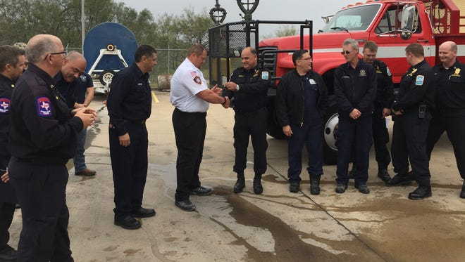 The keys to Refinery Terminal Fire Company's Special Unit One were handed to Ricardo Volunteer Fire Department after a recent Wetting and Push-in ceremony was held for the retired firetruck.