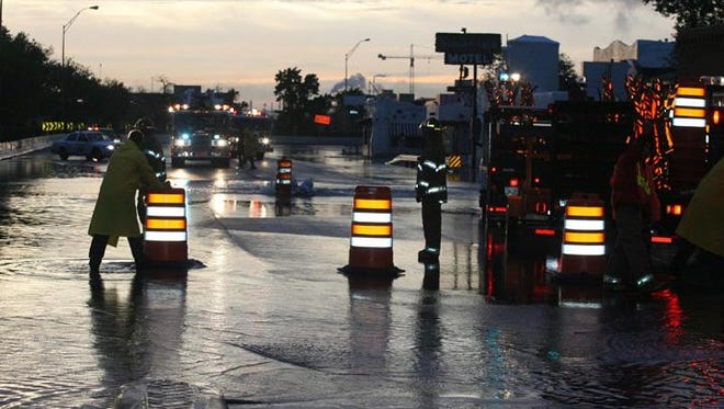 Firefighters closed off Alameda Avenue at Boone Street after an overflowing drain manhole sent water flooding into the street on an early morning in July 2016. The Northeast and Central areas sustained more than $18 million in damage. Many residents, including those in apartment complexes, previously were evacuated during heavy rainfall.