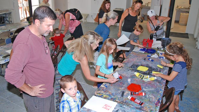 Parents and children enjoy Family Day at the Foosaner Art Museum on May 20, 2017, in the Eau Gallie Arts District.