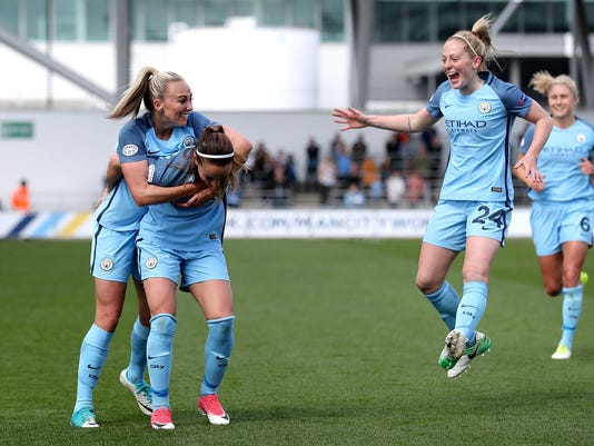 Manchester City's Kosovare Asllani, center, celebrates scoring against Olympique Lyonnais during the women's Champions League semifinal, first leg soccer match at the Academy Stadium, Manchester, England, Saturday April 22, 2017. (Martin Rickett/PA via AP)