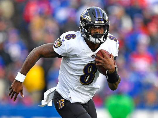 Baltimore Ravens quarterback Lamar Jackson (8) carries the ball during the second half of an NFL football game against the Buffalo Bills in Orchard Park, N.Y., Sunday, Dec. 8, 2019. (AP Photo/Adrian Kraus)