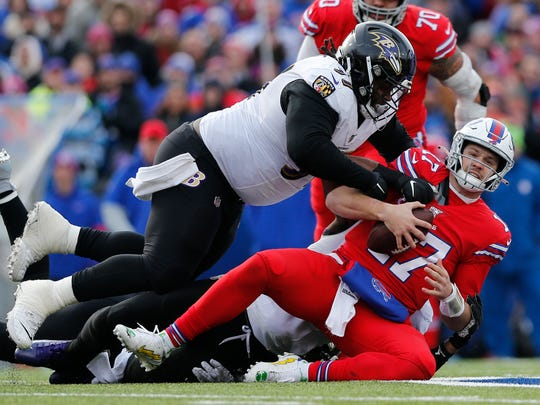 Bills quarterback Josh Allen is sacked by Ravens defensive tackle Michael Pierce last season.