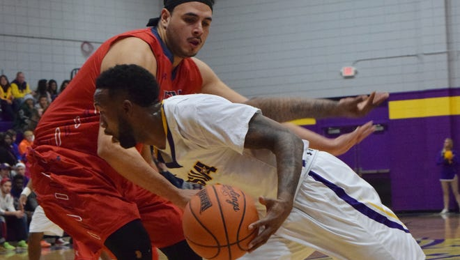 LSU at Alexandria's Darius Johnson (0, front) gets past the University of the Southwest's Pat Beltran (0, back) Saturday.