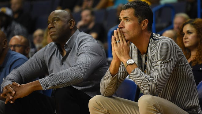 Los Angeles Lakers general manager Rob Pelinka watches the game against the Denver Nuggets with team president Magic Johnson at Citizens Business Bank Arena.