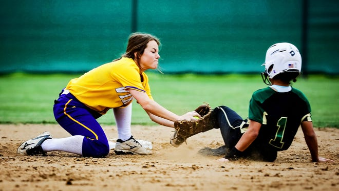 Opelousas Catholic shortstop Courtney Thomassee tags out a Crowley runner.