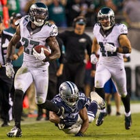 Eagles safety Malcolm Jenkins, shown recovering a fumble during the Eagles 20-10 loss to the Dallas Cowboys last Sept. 20, will team up with Rodney McLeod at safety this season.