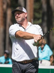 Trent Dilfer hits a tee shot on the fourth hole during the American Century Championship at Edgewood Tahoe Golf Course in Stateline on Saturday.