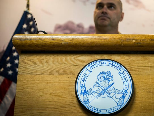 Lt. Col. Matthew Brown answers questions during a news