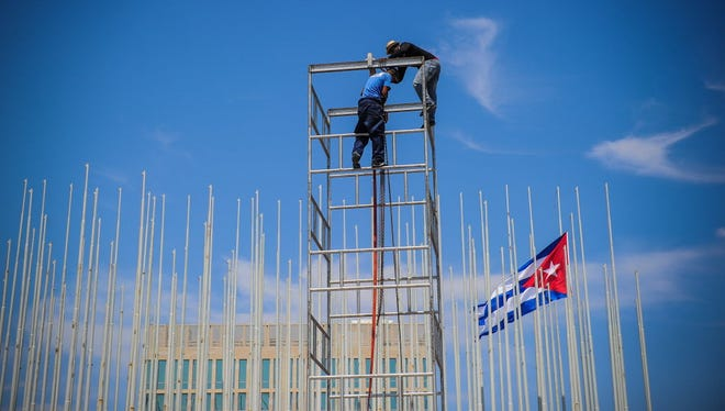 Workers set up a dais Thursday at the U.S. Embassy in Havana during preparations for its inauguration on Friday.