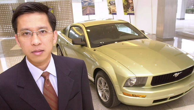 In this Feb. 20, 2004 file photo, Hau Thai-Tang stands next to a Ford Mustang at the Ford's headquarters in Dearborn, Mich. A person briefed on the matter says Ford Motor Co. will announce a management shakeup Thursday, May 25, 2017 that includes replacement of its global product development chief. The person says Vice President of Global Purchasing Hau Thai-Tang will take over product development from Raj Nair. The person says Nair will stay on in another unidentified key management role. He's also Ford's chief technical officer.