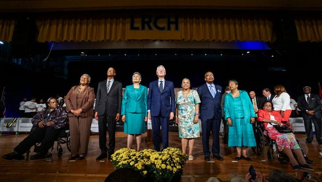 Former President Bill Clinton, center, poses for a photo with the remaining members of the Little Rock Nine, from left, Melba Pattillo Beals, Minnijean Brown Trickey, Terrence Roberts, Carlotta Walls Lanier, Gloria Ray Karlmark, Ernest G. Green, Elizabeth Eckford, and Thelma Mothershed Wair at the end of the commemoration ceremony on the 60th Anniversary of Integration at Little Rock Central High School in Little Rock, Ark., Monday, Sept. 25, 2017.