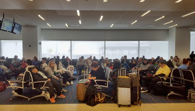 Travelers wait for flights at John F. Kennedy International Airport on Jan. 4, 2018, in the Queens borough of New York City.