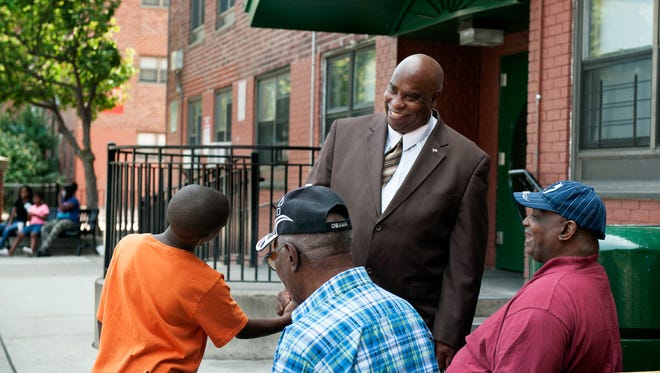 Jeff Gorley, director of public safety for the city of Passaic Housing Authority, meeting with residents of the Alfred Speer Village housing complex in 2014.