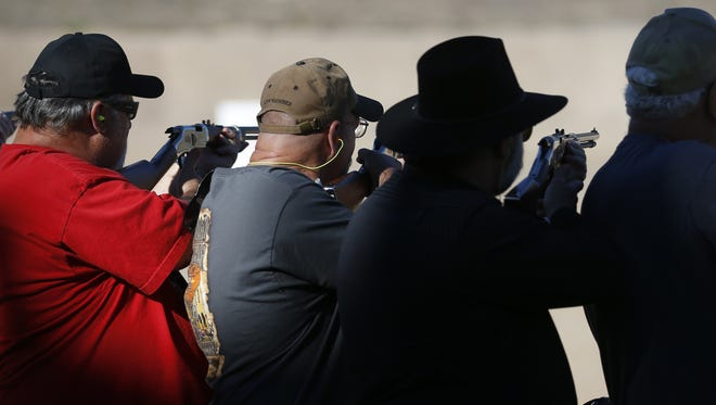 People line up and aim during an attempt to break a world record at the Ben Avery Shooting Facility on November 14, 2016 in Phoenix, Ariz.