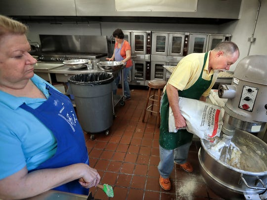 Jim Kennedy (right) and Linda Nichols mix up a batch of  Greek butter cookies called Kourambiethes while preparing for the 60th annual Greek Festival at the Annunciation Greek Orthodox Church.