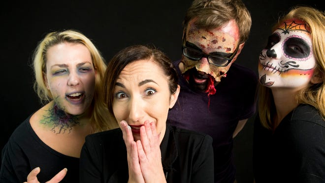 Professional makeup artist Laura Lorusso, center left, poses with Naples Daily News reporters Rebecca Reis, from left, Thaddeus Young, and Shelby Reynolds after dressing them up for the Halloween season.