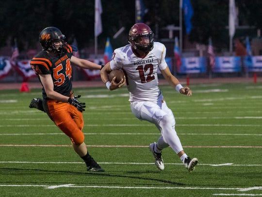 Roosevelt High School Brady Dannenbring (12) runs the