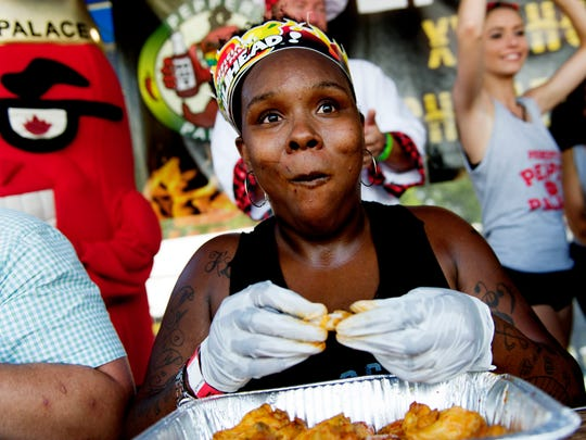 "Latoya Hazel, of Knoxville, competes in the ""XXX Challenge""at the annual Big Kahuna Wing Festival in World's Fair Park in Knoxville, Tennessee on Saturday, June 17, 2017."