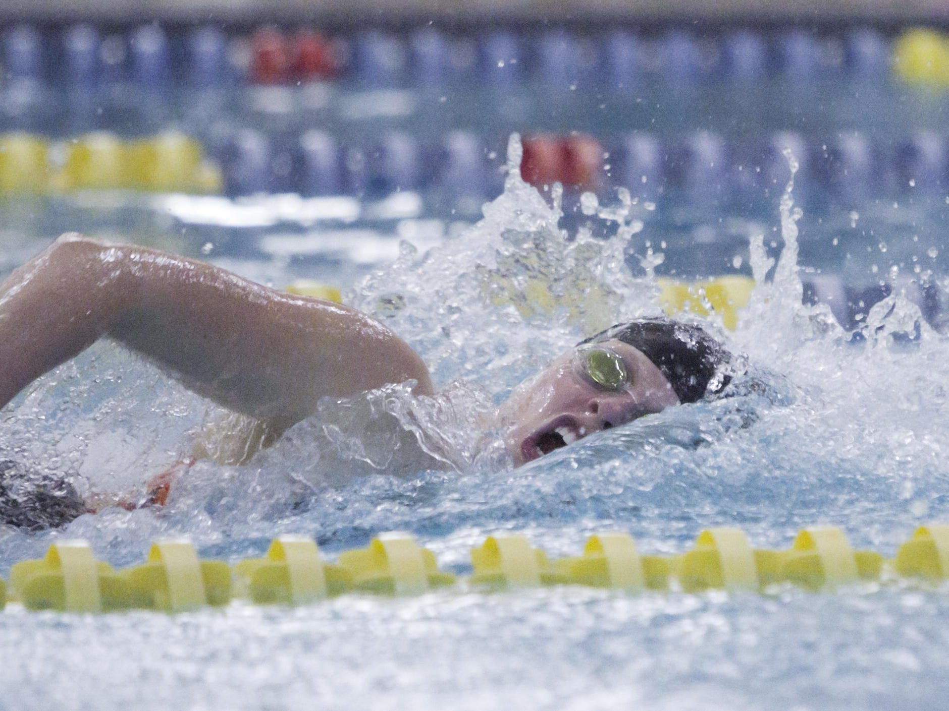 Brighton's Lilia Staszel swims the second leg of the 200-yard free relay, a race the Bulldogs foursome won.